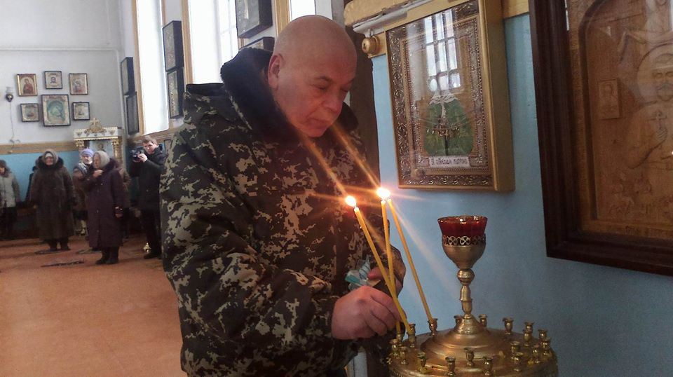 Moskal praying for peace in a church in Tryokhizbenka