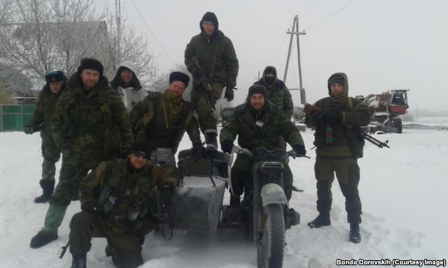 "Militiamen of ""Imperial Legion"", Bondo Dorovskih on a motor-bike"