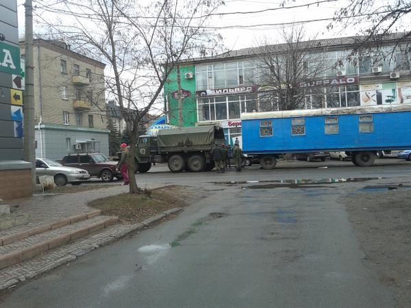 Russian army trucks and soldiers in Lugansk, Ukraine