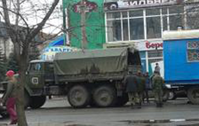 Russian army truck and soldiers