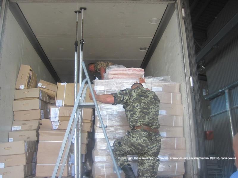 Border guards checking truck with meat