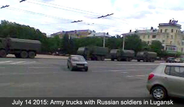Military trucks with Russian Army soldiers in Lugansk