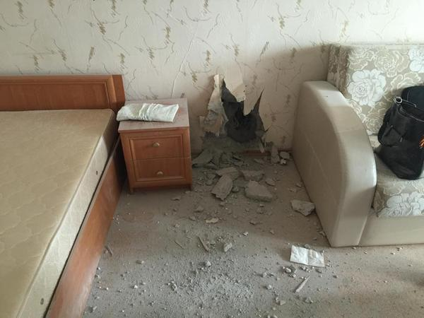 Damage from a tank shell that hit the residential building in Donetsk