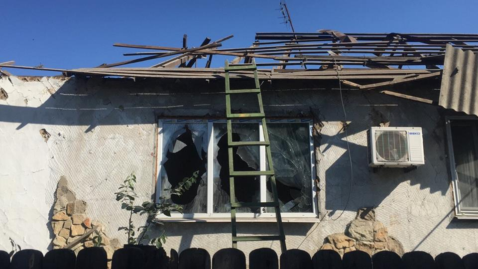 Damaged house in Toshkivka