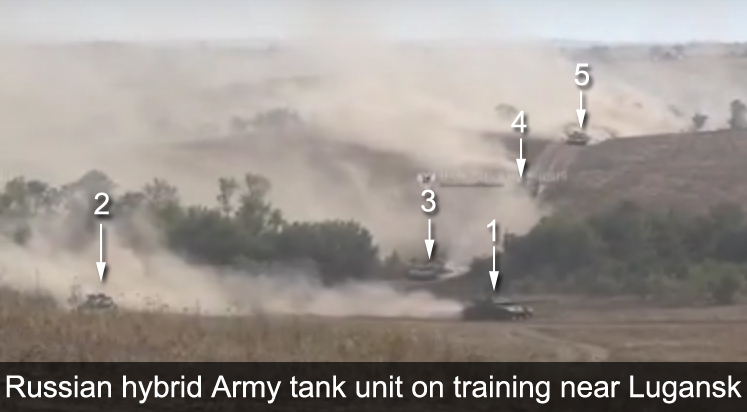 Russian hybrid army tank units training near Lugansk