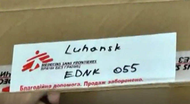 Representatives of LPR opened a box of vitamins at storehouse of Doctors Without Borders (MSF)