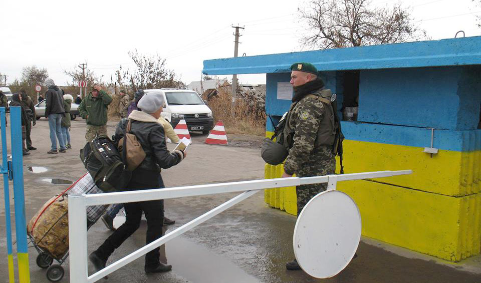 People crossing checkpoint in Stanytsia Luhanska
