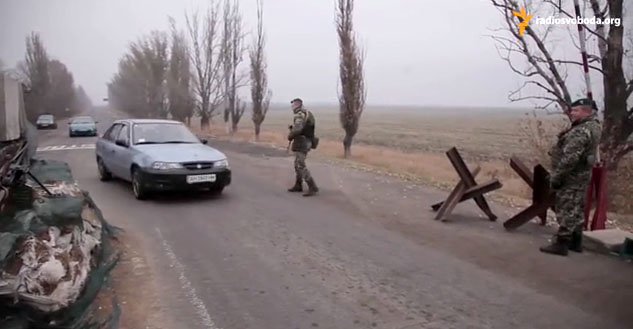 "Cars going through ""Heorhiivka"" checkpoint"