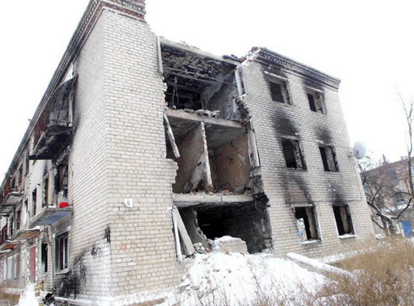 Damaged building in outskirts of Mariinka