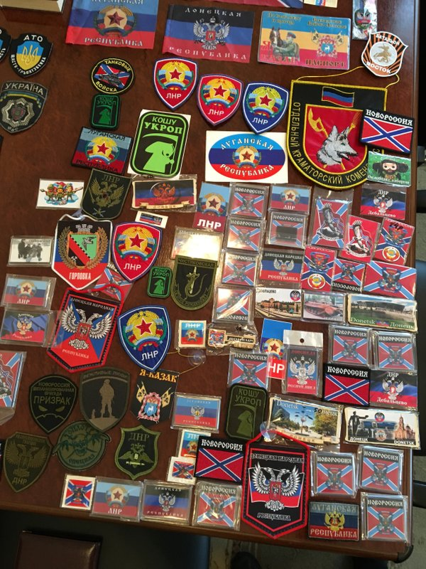 Military insignia of DPR and LPR militants that Russian soldiers had with them