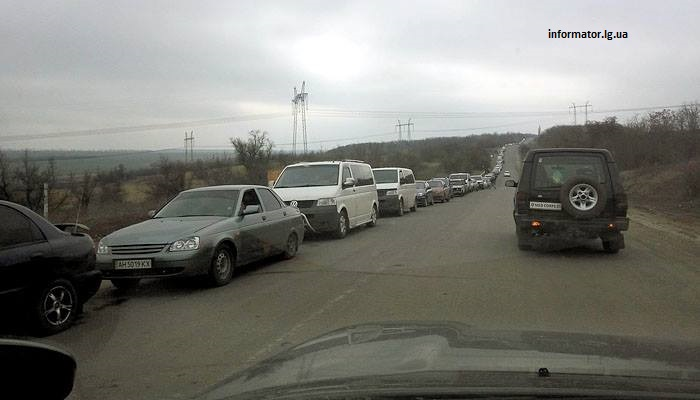 "Line of vehicles going through ""Zaitseve"" checkpoint. Photo by informator.lg.ua"